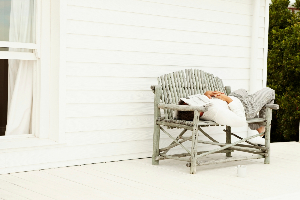 Mature-man-sleeping-on-a-bench-outside-his-house-000013015437 Double-929