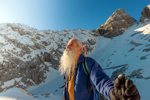 iStock-636900410 old man mountain snow guru